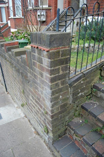 Brick pier with tile creasing