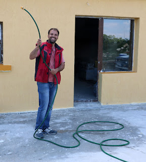 Ivan waving a hose around