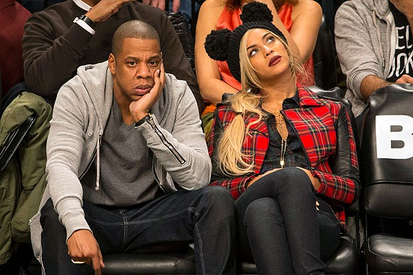 Beyonce and Jay-Z at a basketball game