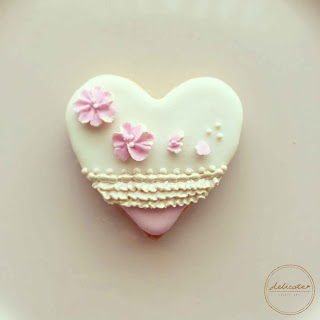 heart cookie with  piped flower and ruffles in natural food colourings