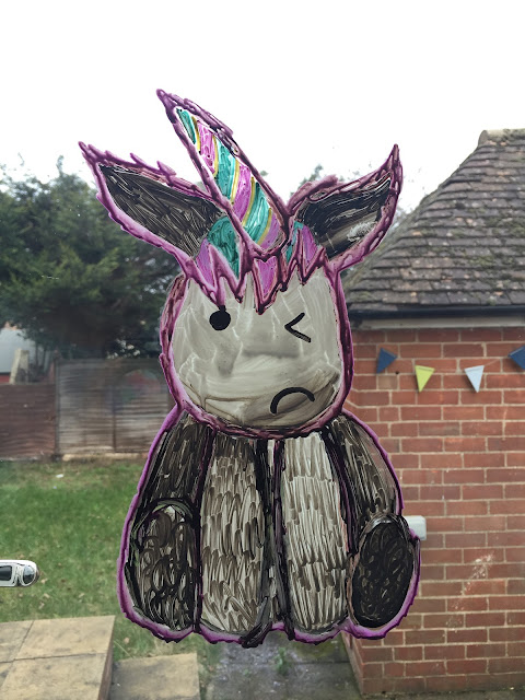 Unicorn on window using chalk pens