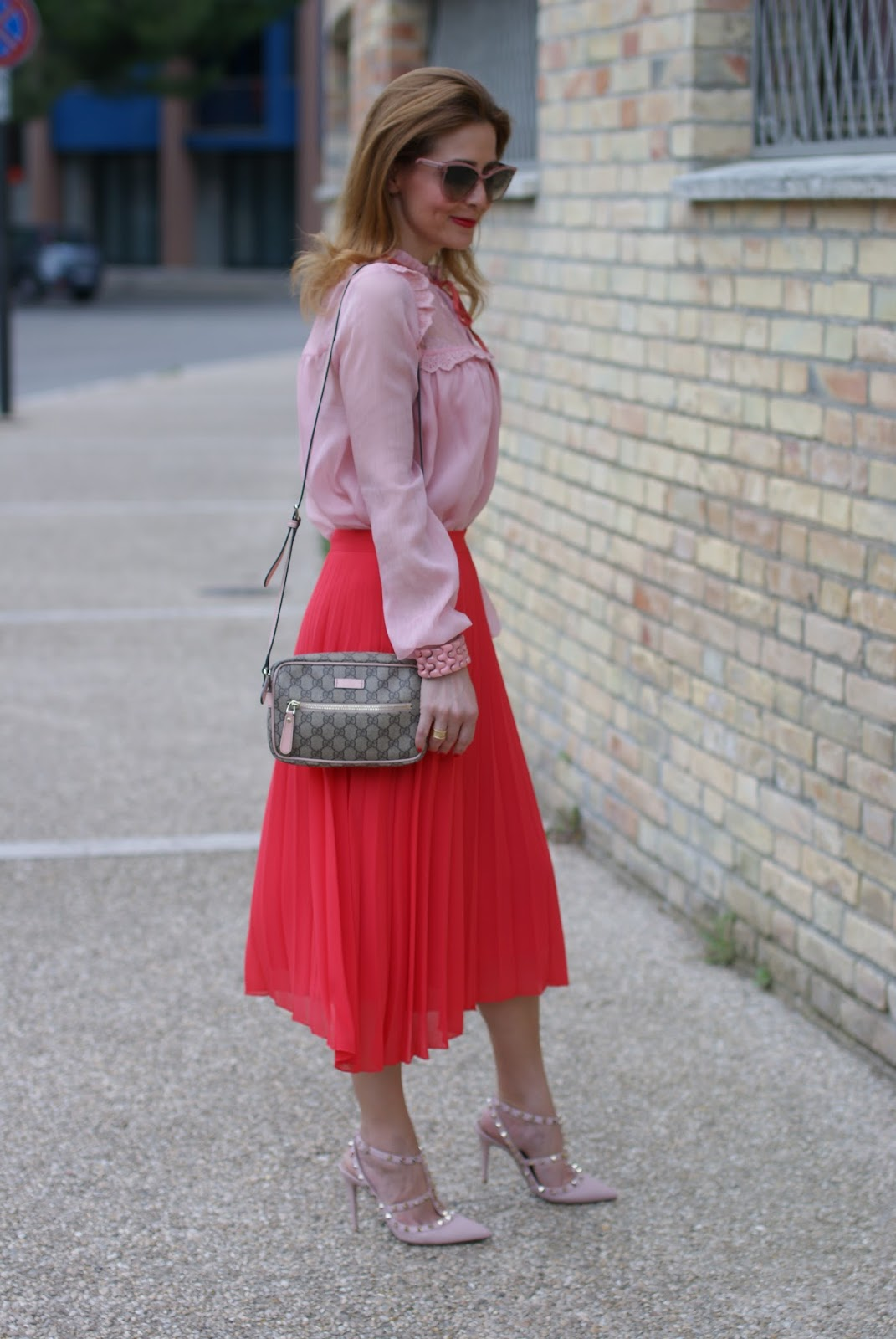Gucci inspired outfit with valentino rockstud in pink, red pleated midi skirt and chiffon and lace pink shirt on Fashion and Cookies fashion blog, fashion blogger style