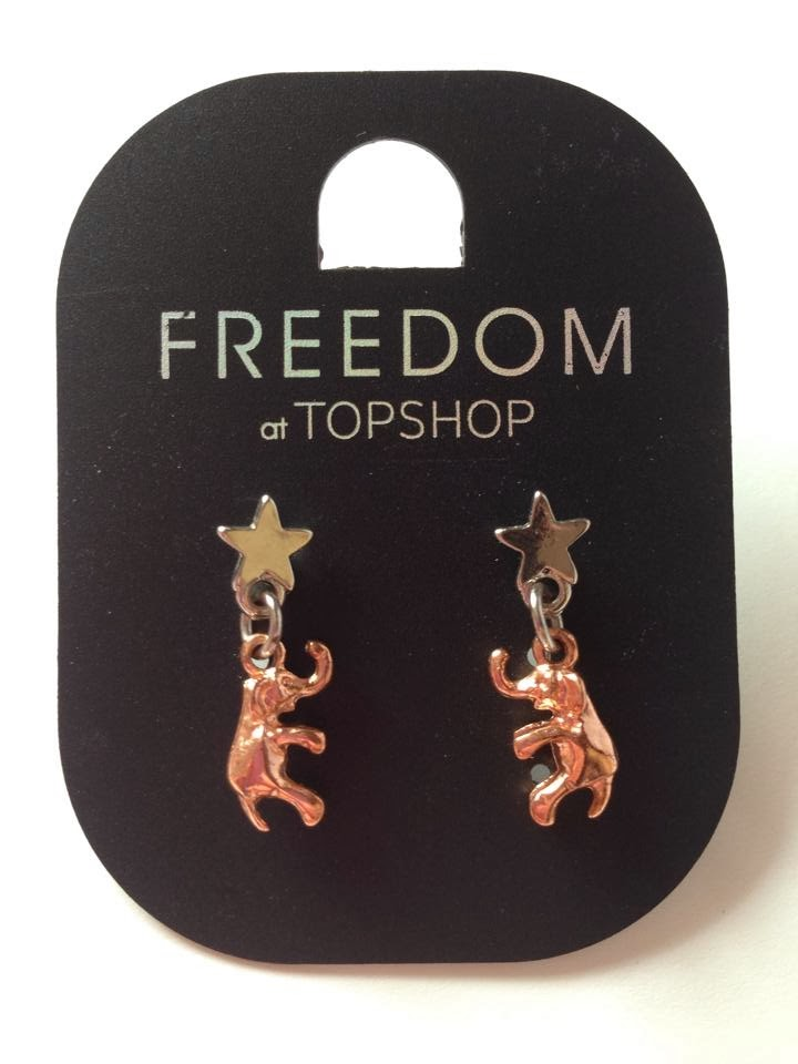 Silver and rose gold elephant earrings from Topshop.