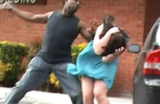A black man beating a white lady