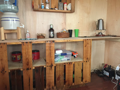 Tiny house kitchen counter top made of re-purposed wood pallets.
