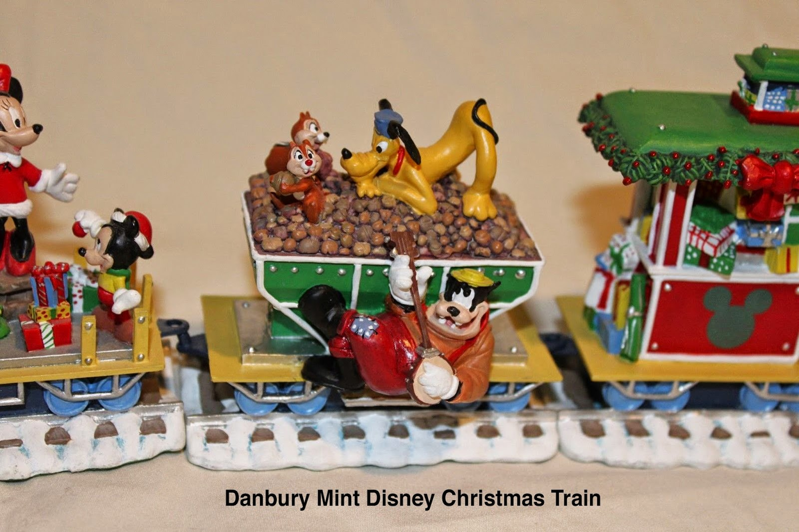 the danbury mint disney mickey mouse christmas train has a banjo playing pete riding the rails - Disney Christmas Train