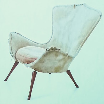 Slide of a battered Grant Featherston E51 chair.