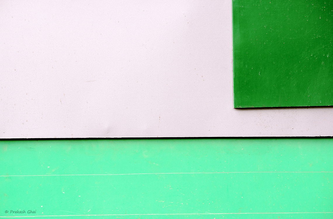 A Minimalist Photo of a Green Square versus the long light green rectangle and white negative space.