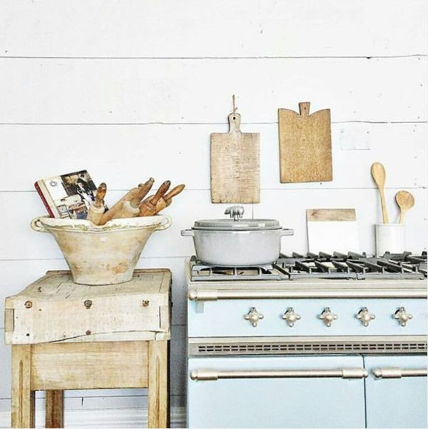 Sometimes one singular statement in a kitchen (like a gorgeous blue #Lacanche range) can contribute to the harmony of rustic and elegant. #kitchendesign #farmhousekitchen