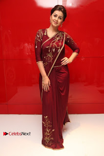 South Indian Actress Nikki Galrani Stills in Red Designer Saree at Maragadha Naanayam Tamil Movie Audio Launch  0017.jpg