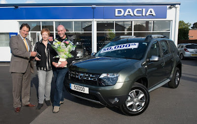 The lucky owners of the 50,000th UK Dacia!