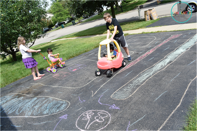 learn about road signs, roads and cars with this fun chalk on driveway kids activities