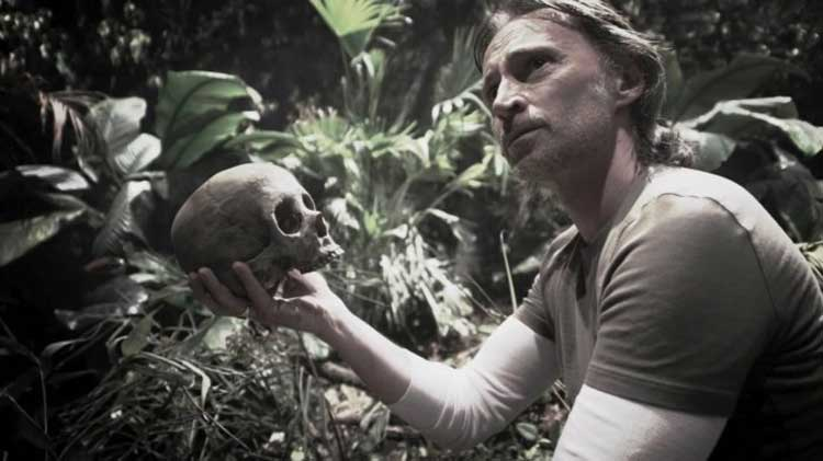 "Rush holds up his own skull in the Stargate Universe episode ""Time"""