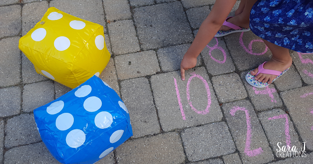 With dice and chalk, you've got an easy way to practice counting and addition outside in the summer. You could use the same concept and bring it into the house or classroom in the winter.