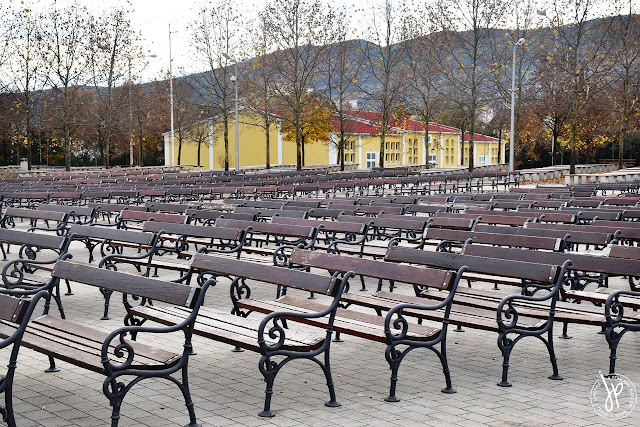 empty benches behind Saint James Church in Medjugorje