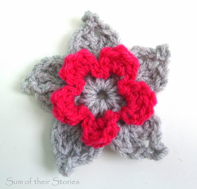 grey and bright crochet flower