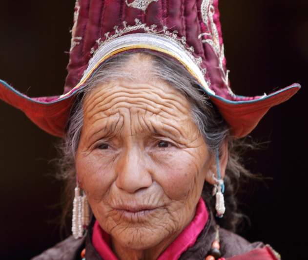 The innocent wrinkled face of an elderly Ladakhi lady at Hemis Monastery festival 2016