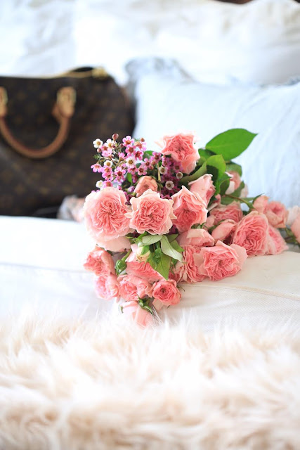 garden roses and louis vuitton with blush faux fur and blue linen pillows