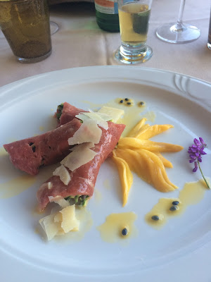 Carpaccio of beef with asparagus, served with mango, parmesan and a passion fruit drizzle