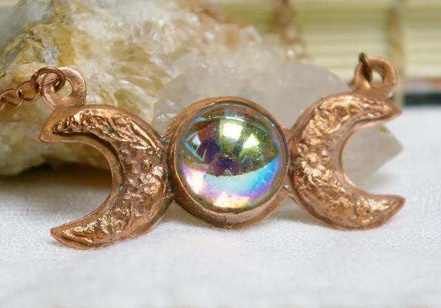 https://www.etsy.com/ca/listing/614281082/triple-moon-aura-glass-pendant-aurora-ab