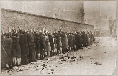 JEWISH FIGHTERS CAPTURED AND LINED UP AGAINST THE WALL - WARSAW GHETTO UPRISING