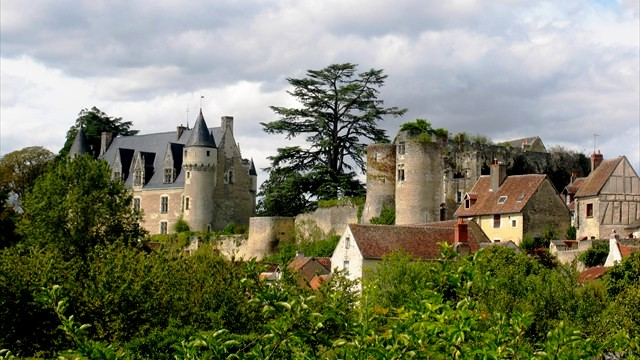 Looking up towards Chateau de Montresor from the river in the village of the same name in Centre-Val de Loire France