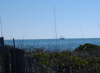 View Oak Island NC photos of the ocean and fishing boats