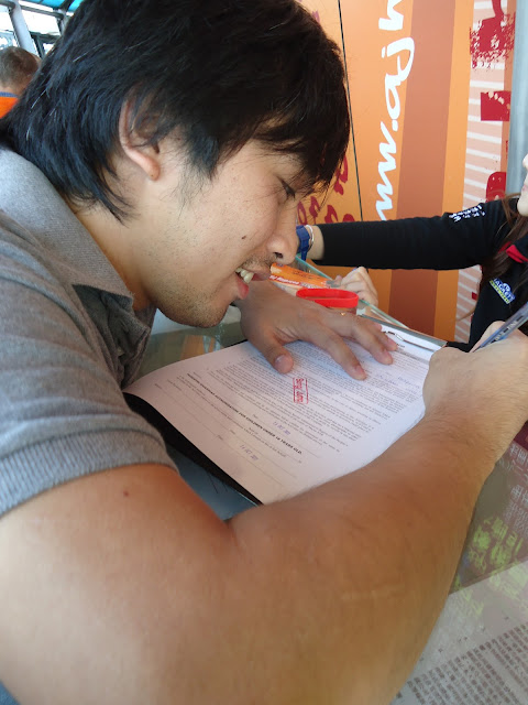 Ed Signing up for the bungee jump at Macau Tower