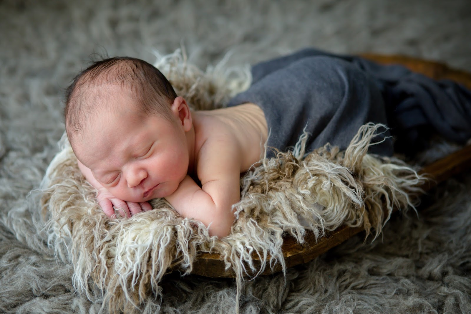 newborn laying in earth tones