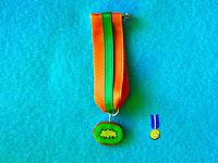 Foto Medalla rodaja de Kiwi de fimo