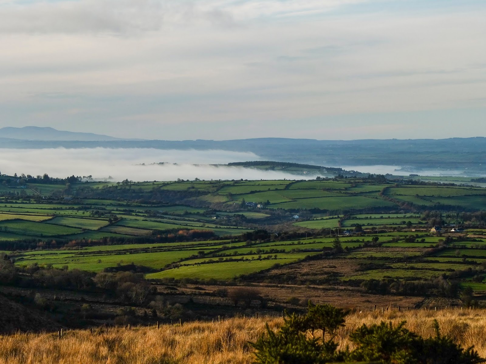 Clouds of fog rolling down a valley in North Cork on a sunny morning.