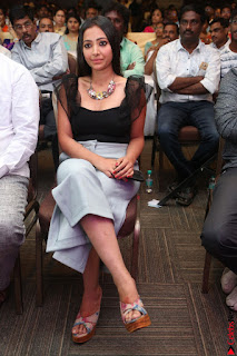 Swetha Basu in a Black Sleeveless Top Long Skirt at Mixture Potlam Movie Audio Launch 047.JPG