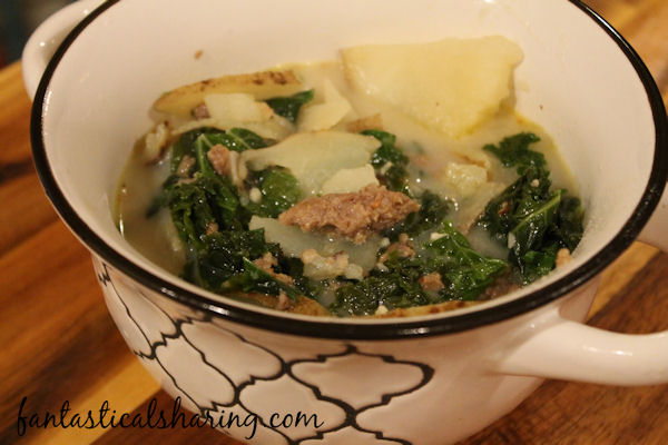 Spicy Sausage, Kale, & Potato Soup // This hearty soup packs a punch and is ready in 30 minutes! #recipe #soup #kale