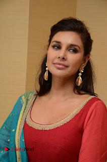 Lisa Ray Sizzles in a Tight Orange Salwar Suit at Veerappan Movie Pressmeet