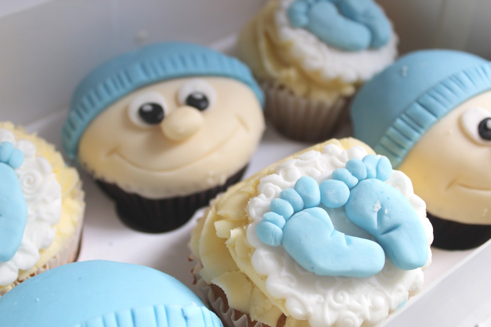 close up of homemade baby boy and baby feet cupcakes