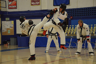 Black belts sparring at the Denver Martial Arts Championships Tournament