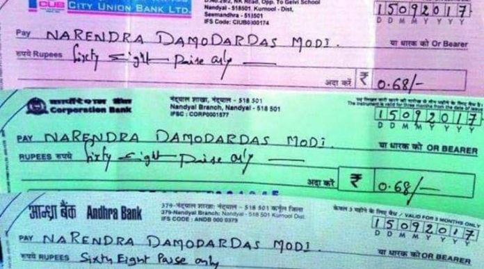 andhra-pradesh-farmers-gifts-68-paisa-cheque-narendra-modi