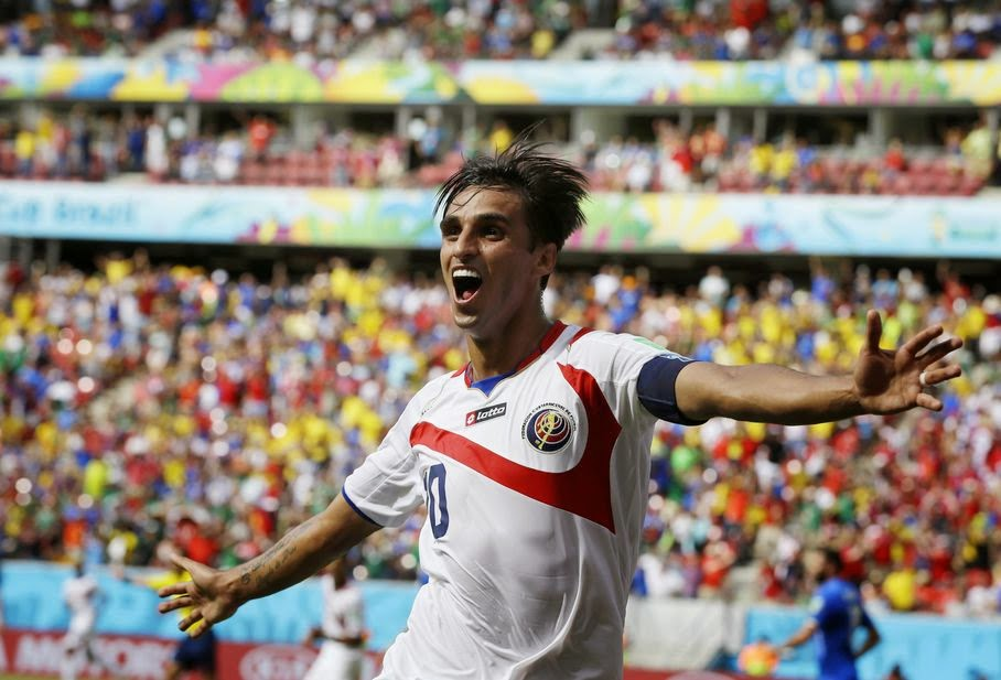 Costa Rica's Bryan Ruiz celebrates after scoring his side's first goal over Italy's goalkeeper Gianluigi Buffon during the group D World Cup soccer match between Italy and Costa Rica at the Arena Pernambuco in Recife, Brazil, Friday, June 20, 2014.