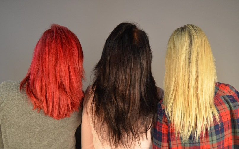 three women with different dyed hair colors.jpeg