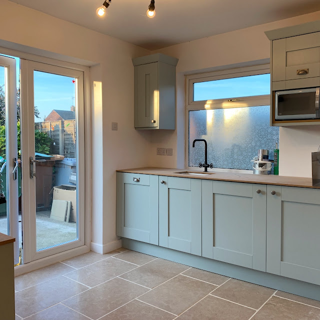 light blue kitchen with limestone floor DIY-kitchens