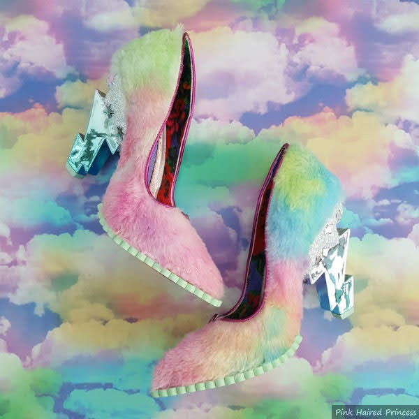 pair of shoes with furry, pastel rainbow uppers and lightning bolt heels on cloud background