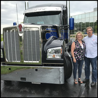 Lessa Martin and Mark Hollen with a new Kenworth W990
