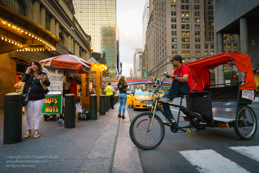 a photo of taxis and pedicabs in front of grand central station new york