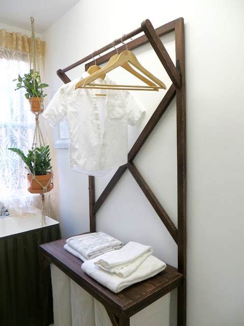 A Rod At The Top For Hanging Clothes To Dry Or Prevent Wrinkles As They Come Out Of Dryer