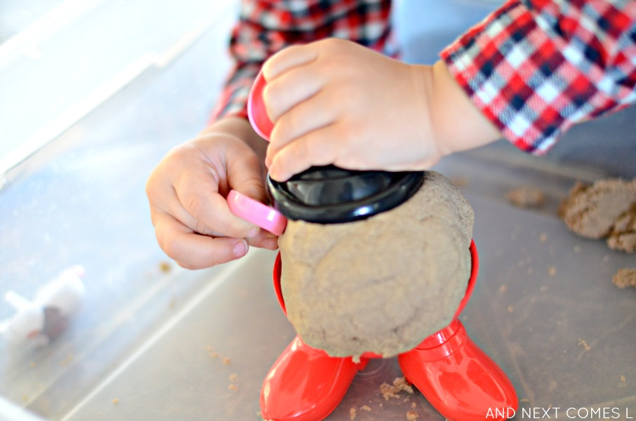 Fun way to play with kinetic sand using potato head pieces