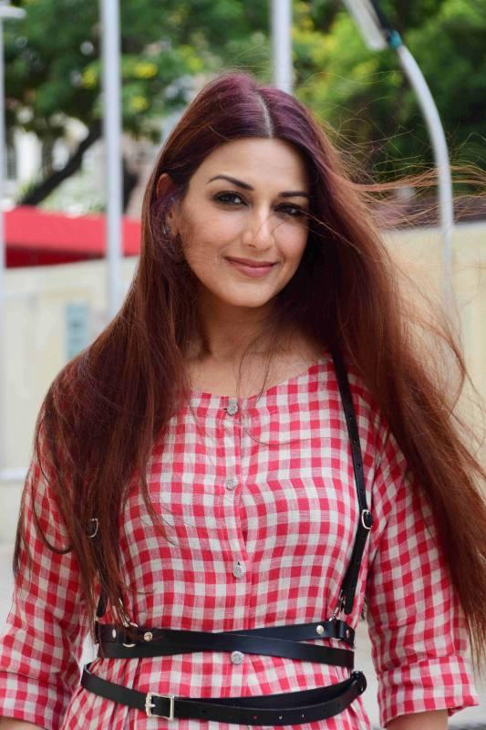 North Indian Actress Sonali Bendre Long Hair Photos In Red Top Jeans