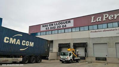 impresión e instalación de lona en nave industrial