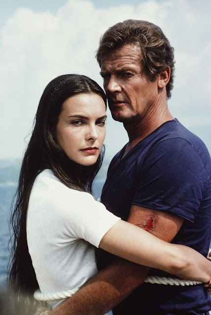 Carole Bouquet as Melina, Roger Moore as James Bond  in For Your Eyes Only in 1981.
