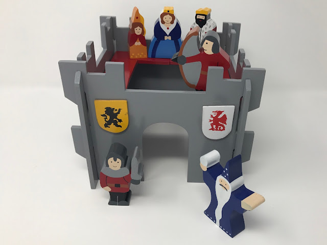 The Wooden castle set on a white background showing the front and top of the castle and the characters