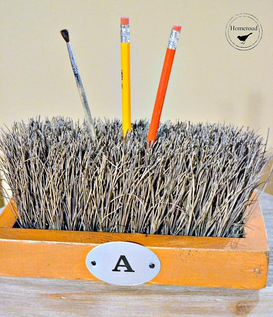 DIY push broom office pencil holder